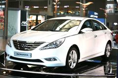 2011 Sonata Hyundai. Of white color a headlight and the polished body at an exhibition to sale at the international airport Incheon ,Seoul, Korea 90june 2010 Royalty Free Stock Photography