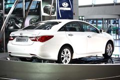 2011 Sonata Hyundai. Of white color a headlight and the polished body at an exhibition to sale at the international airport Incheon ,Seoul, Korea 9 june 2010 Stock Photo