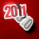 2011 sticker. 2011 over 2010 sticker - image over a red background royalty free illustration