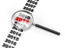 2011 under magnifying glass. On white background Royalty Free Stock Images