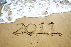 2011 year on sand. 2011, a new year word on sand Stock Photo