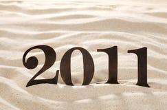2011 Zahlen des neuen Jahres Metalauf Strandsand Lizenzfreies Stockfoto