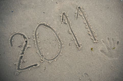 2011 in zand Stock Foto