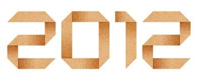 2012年字母表纸板在origami年上写字 库存照片