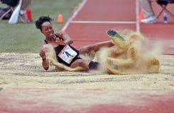 2012 atletismo - aterrizaje de la triple salto Imagen de archivo libre de regalías