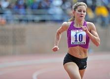 2012 atletismo - corredor da milha das senhoras Foto de Stock Royalty Free