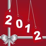 2012 background. Red 2012 tags with silver bow, background. vector royalty free illustration