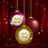 2012 bingo baubles. Festive New year baubles on a red silk background Stock Images