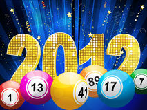 2012 bingo lottery balls and streamers. Bingo or lottery balls with 3d sparkling 2012 and streamers on a blue star burst background Stock Photos