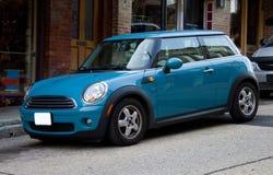 2012 Blue Mini Cooper. Two door sedan parked on an incline in Eureka Springs, Arkansas Stock Image