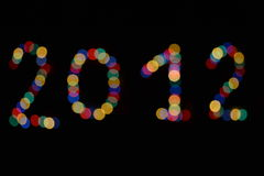 2012 Bokeh. Blurred text in 2012 new year Stock Photography