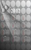 2012 business style calendar, cdr vector. 2012 business style calendar on grey background with months in white and grey christmas ornaments, vector format Royalty Free Stock Images
