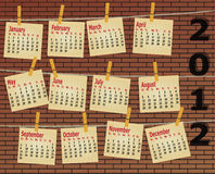 2012 calendar on brick wall. With strings and papers Royalty Free Stock Image