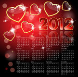 2012 calendar with hearts. Glossy heart calendar on a sparkling background Royalty Free Stock Image