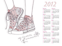 2012 calendar with shoes. floral pattern sneakers. 2012 calendar with shoes. Shoes with floral pattern. Background with fashionable sneakers Royalty Free Stock Photo