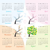 2012 calendar - week starts on Sunday. Four seasons (trees in spring, summer, autumn and winter Stock Image