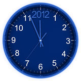 2012 on clock. Blue round clock with arrows and number 2012  in the top part Royalty Free Stock Images