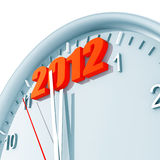 2012 on clock. Round clock with arrows and red number 2012  in the top part Royalty Free Stock Image