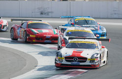 2012 Dunlop 24 Hours Race in Dubai. DUBAI - JANUARY 13: Competitors coming through curve 1 during the 2012 Dunlop 24 Hour Race at Dubai Autodrome on January 13 stock images