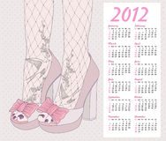 2012 fashion calendar. Background with shoes. 2012 fashion calendar. Background with high heels shoes. Tights with birds and flowers ornament lace Royalty Free Stock Photography