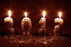 2012 felice - bruciatura delle candele Fotografia Stock