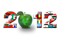 2012 flags and apple world. The number 2012 in world flags and globe shaped as a green apple Stock Image
