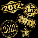 2012 Gold Stamps. 2012 Gold new year rubber stamp illustrations Stock Photos