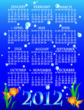 2012 goldfish calendar. Fun and colorful complete 2012 goldfish calendar with algae and bubbles over deep blue water stock illustration