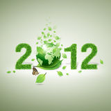 2012 grass material, leaf and world. 2012 New year made of grass material. consists of world and green leaf and butterfly royalty free stock images