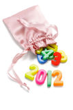 2012 Happy New Year. Year 2012 and colorful plastic alphabet blocks in sachet Stock Photography