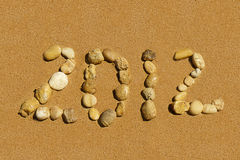 2012 inscription on the golden sand Stock Image