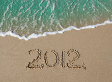 2012 Inscription On The Sand Near The Sea Royalty Free Stock Photo