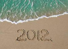 2012 inscription on the sand near the sea. 2012 inscription on the sand near the azure sea Royalty Free Stock Photo