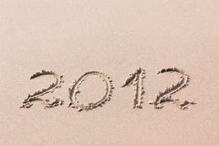 2012 Jaar dat op het zand wordt geschreven Royalty-vrije Stock Afbeeldingen