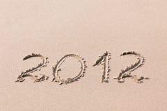 2012 Jahr geschrieben auf den Sand Lizenzfreie Stockbilder