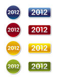 2012 Labels. Round and square colorful labels for 2012 in blue, red, yellow and green Royalty Free Stock Photo