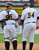 2012 Minor League Baseball Action. TRENTON, NJ - JUNE 4: Trenton Thunder pitcher Ryan Flannery (54) and catcher Jose Gil (55) talk on the mound during the Royalty Free Stock Photography