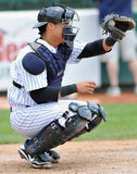 2012 Minor League Baseball Action. TRENTON, NJ - JUNE 4: Trenton Thunder catcher Jose Gil catches a ball during the eastern league baseball game against New Royalty Free Stock Images