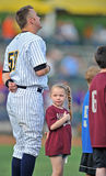 2012 Minor League Baseball action. TRENTON, NJ - JUNE 9: A young girl looks back to the crowd as she stands next to Thunder first baseman Luke Murton (59) prior Stock Images