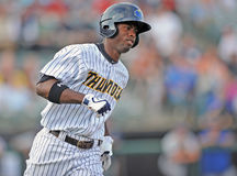2012 Minor League Baseball action. TRENTON, NJ - JUNE 9: Trenton Thunder outfielder Melky Mesa sprints to first base after making contact with a pitch during the Stock Photography