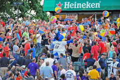 2012 Minor League Baseball action. TRENTON, NJ - JUNE 9: Fans in the stands compete in a beach ball contest between innings of the Eastern League baseball game Royalty Free Stock Photos