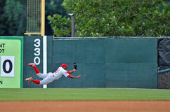 2012 Minor League Baseball Action. TRENTON, NJ - JULY 21: Reading Phillies outfielder Leandro Castro makes a diving catch in the outfield duringan Eastern League Royalty Free Stock Images