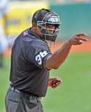 2012 Minor League Baseball Action. TRENTON, NJ - AUGUST 8:  The home plate umpire of an Eastern League game between Trenton and Reading signals strike two August Royalty Free Stock Photography