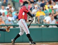 2012 Minor League Baseball action. TRENTON, NJ - August 21: Altoona Curve first baseman Matt Curry swings at a pitch during an Eastern League baseball game Royalty Free Stock Photos