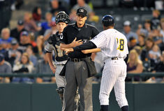 2012 Minor League baseball - Eastern Lge Champion. TRENTON, NJ - SEPTEMBER 15: Trenton manager Tony Franklin (#18) argues with the home plate umpire after a Stock Photos