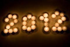 2012 mit Kerzen Stockfotos