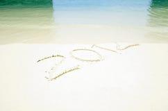 2012 na areia da praia Fotos de Stock Royalty Free