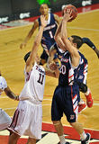 2012 NCAA Basketball - defense on a jump shot Royalty Free Stock Photography