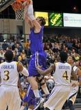 2012 NCAA Men's Basketball - Drexel - JMU. PHILADELPHIA - FEB 22: James Madison Dukes center Gene Swindle (44) has a slam dunk during the NCAA basketball game Royalty Free Stock Photography