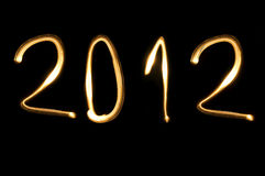 2012,new year. Number 2012 written with light on a black background Stock Image
